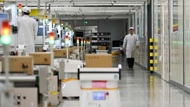 傳華為積極收購中國半導體企業股權 彌補供應鏈缺口 (圖:AFP)