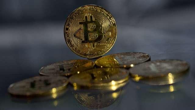 比特幣交易太火熱 交易平台:必要時可能限制周末買入(圖:AFP)