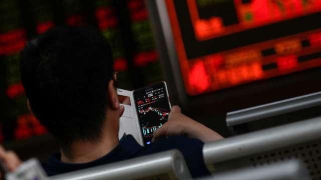 護國神山發威 台股大漲265點收15877點續創新高。(圖:AFP)