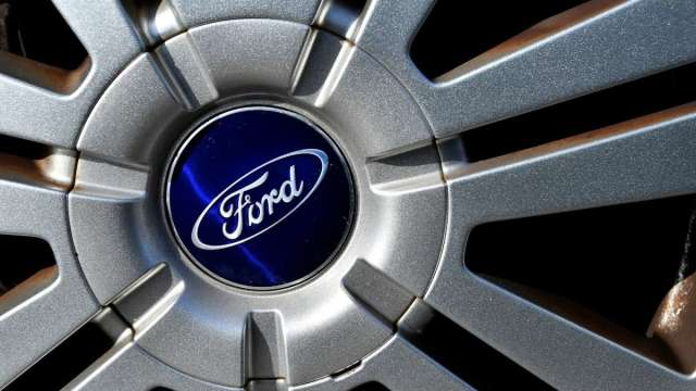 搭上電動車狂潮!傳統車廠拚翻身 福特、通用今年來飆漲逾30% (圖:AFP)