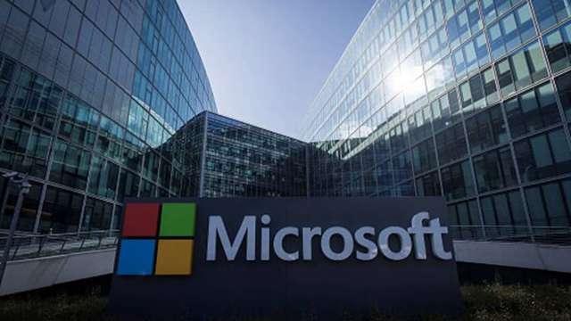微軟、超微財報報喜,台廠營運添動能。(圖:AFP)