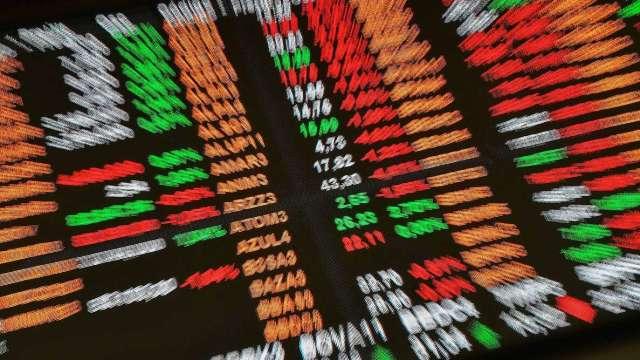 從去年低點以來,美國股市上漲超過70%,2020整年漲幅也有18.4%。(圖:AFP)