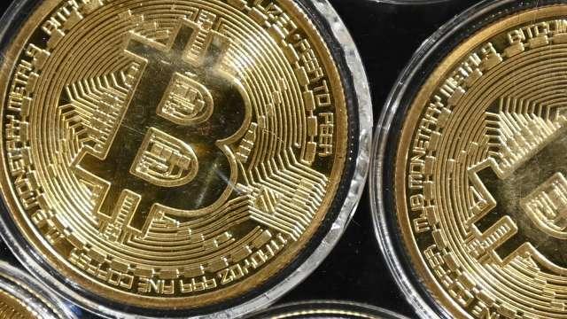 Robinhood稱市場狀況特殊,暫時關閉加密貨幣的即時存款 (圖:AFP)