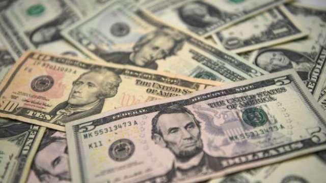 經濟數據疲軟市場憂美元超漲 美元多轉空周跌近1%(圖:AFP)