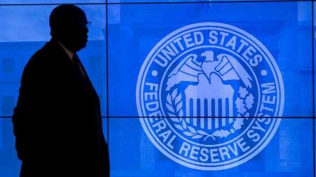 1月會議紀要:Fed一段時間內不會縮減購債 (圖片:AFP)