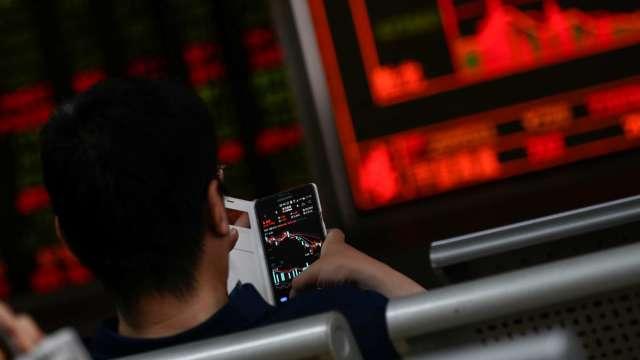 〈焦點股〉全球拚年底解封 多檔觀光股營運見曙光噴漲停。(圖:AFP)