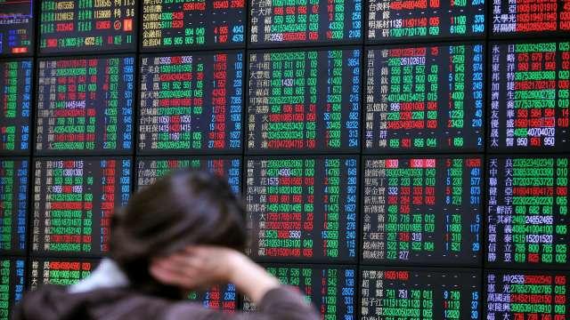 傳產金融火力全開 台股翻紅漲33點收16443點續寫收盤新高。(圖:AFP)