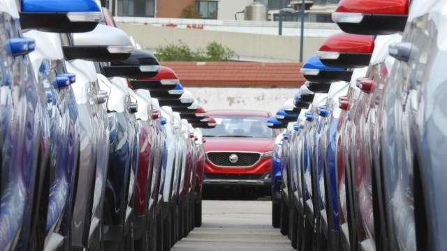 汽機車熱銷助攻 1月零售業營收續創新高、批發業寫次高。(圖:AFP)