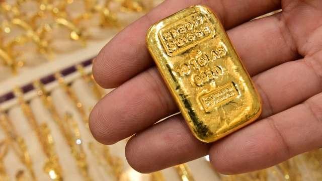 〈貴金屬盤後〉債券殖利率再上升 美元堅挺 黃金跌至9個月低點(圖片:AFP)