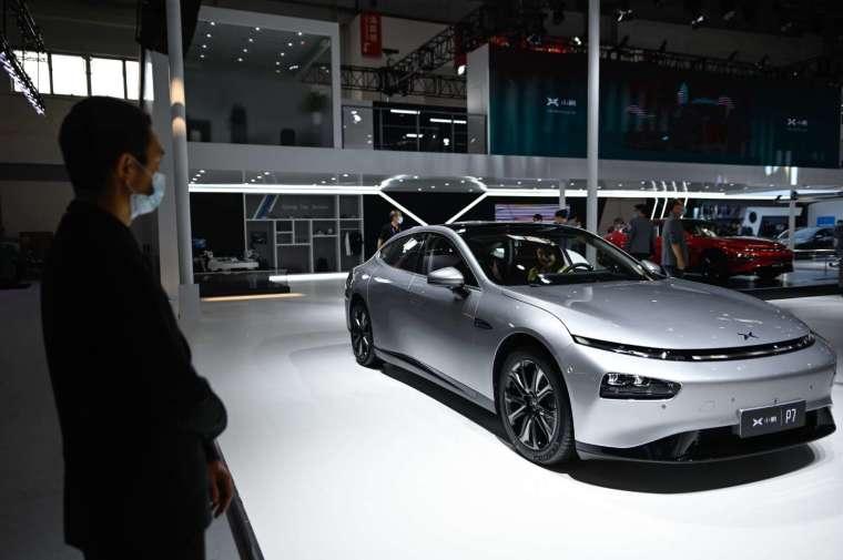 電動汽車股集體走揚。(圖片:AFP)