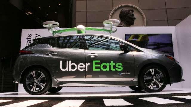 魚與熊掌得兼!分析師喊買Uber﹔經濟重啟 叫車量回升 外賣量也不會掉  (圖片:AFP)