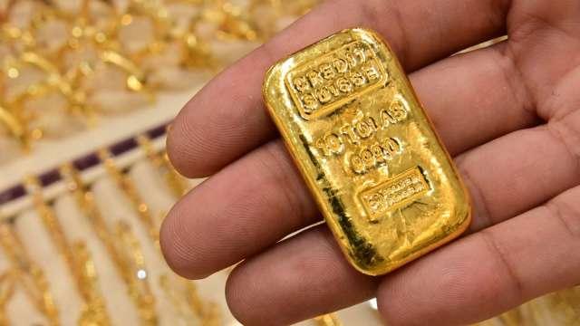 〈貴金屬盤後〉Fed消息帶動美元走貶 黃金脫離早盤低點 小幅收高 (圖片:AFP)