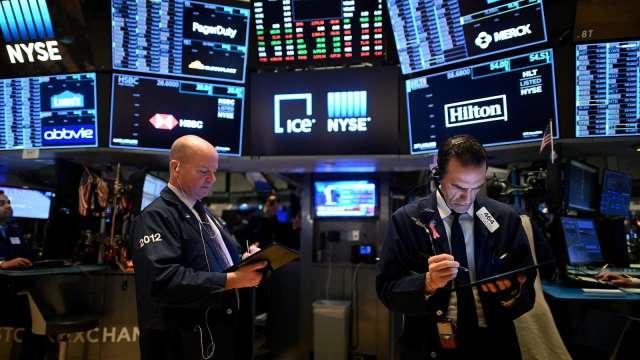 〈美股早盤〉經濟復甦樂觀情緒升溫 美股全線高開 銀行股樂漲 (圖:AFP)