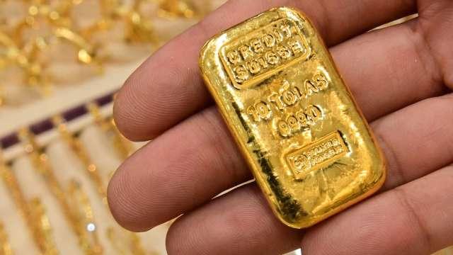 〈貴金屬盤後〉季末空頭回補 黃金收高 但本週仍見3週來首次收低 (圖片:AFP)
