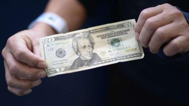 短期不看空!高盛:美國強勁經濟和債息走揚可望支撐美元 (圖:AFP)