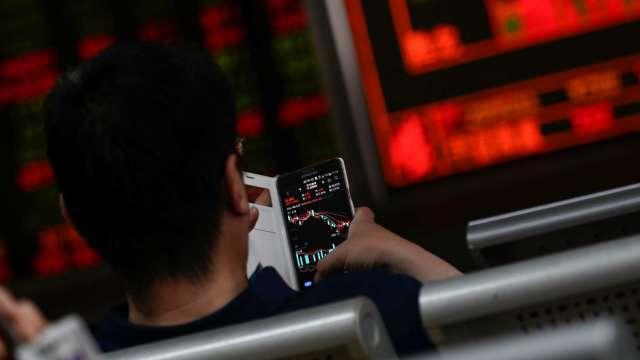 台股漲168點收16739點 收盤、盤中雙寫新高。(圖:AFP)