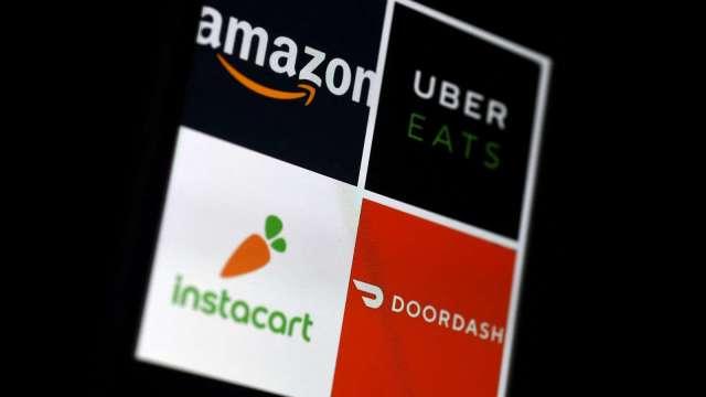 美國外送平台Instacart、DoorDash擬推信用卡 擴大開發客源(圖片:AFP)