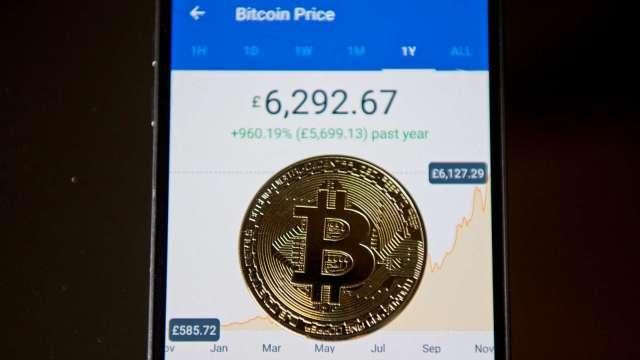 Coinbase上市在即 三大平台幣搭便車齊漲。(圖:AFP)