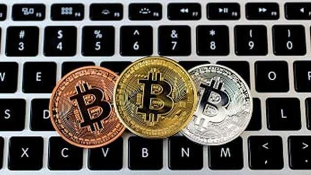 Coinbase上市助攻比特幣攀6.3萬美元創新高,板卡廠可望受惠。(圖:AFP)