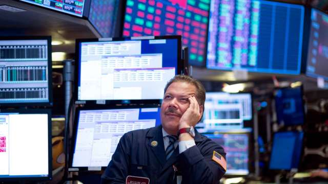 Coinbase上市首日漲逾30% 三大指數收黑。(圖片:AFP)