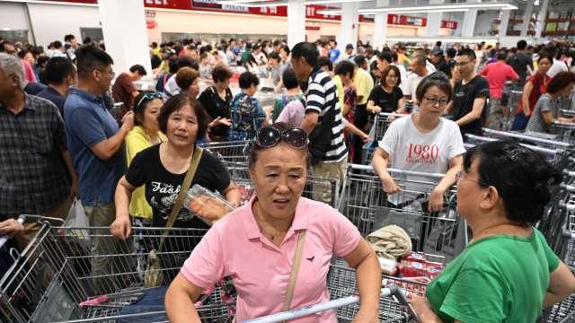 中國1~3月消費品零售年增33.9% 優於預期(圖片:AFP)