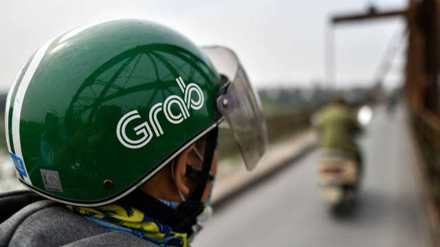 才剛宣布赴美SPAC掛牌 傳Grab計畫回流新加坡二次上市 (圖:AFP)