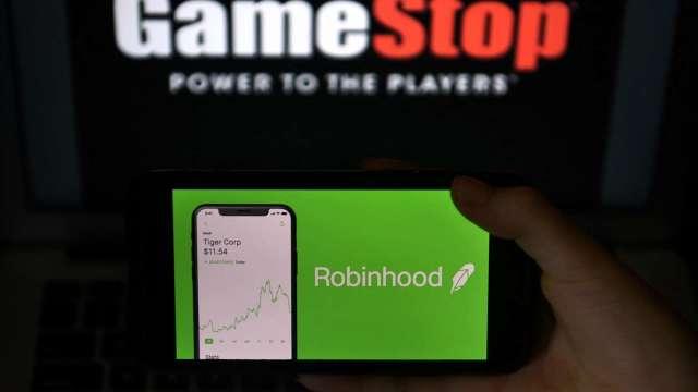 加密貨幣夯 羅賓漢、Coinbase手機App在美最受歡迎(圖片:AFP)