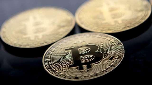 數位貨幣蔚為風潮!英國央行研究「Britcoin」 華爾街看好顛覆潛力 (圖:AFP)