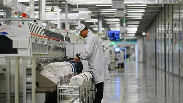 中國蘋果一哥立訊2020年營收年增48%;純益年增53%(圖片:AFP)