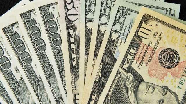 投機者再減美元多頭 降日圓空頭(圖:AFP)