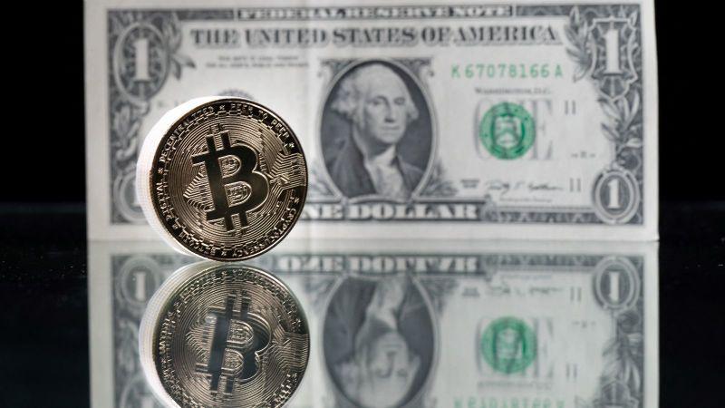 標普道瓊指數公司推出加密貨幣指數 將比特幣、以太幣領入華爾街(圖片:AFP)