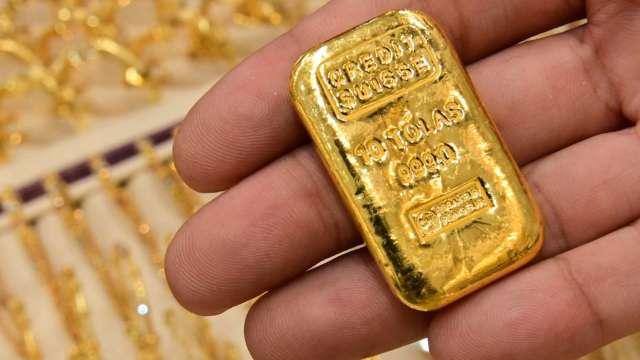 〈貴金屬盤後〉黃金收登關鍵心理價位1800美元以上 今年2月來最高水準 (圖片:AFP)