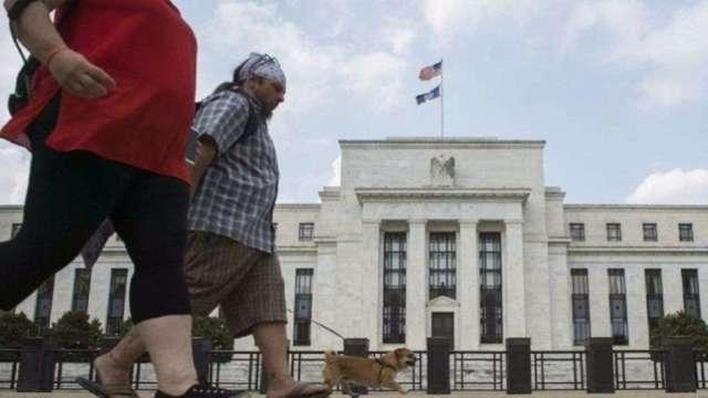 聯準會暗示2023年前無升息計畫,拉抬高收益債行。(圖:AFP)