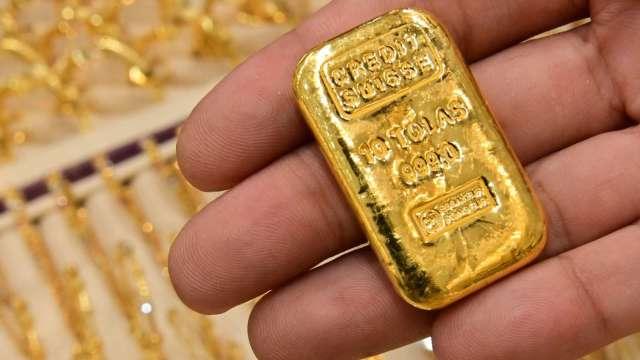 〈貴金屬盤後〉4月非農就業太慘 黃金收登3個月高點 (圖片:AFP)