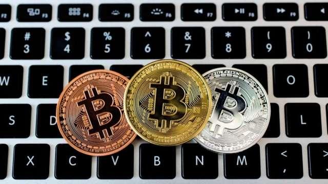 加密貨幣掀投資熱潮 ,需留意交易所得要。(圖:AFP))