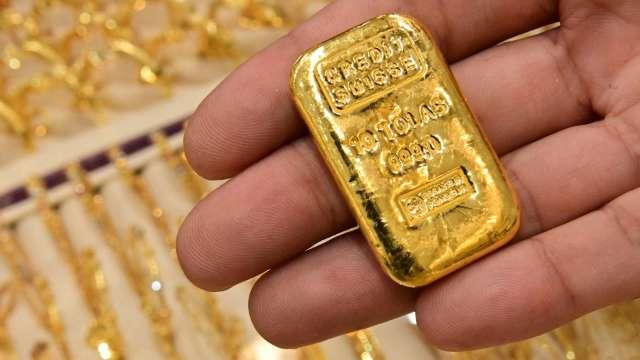 〈貴金屬盤後〉公債殖利率上升 200日MA近阻力點 黃金自3個月高點回落 (圖片:AFP)