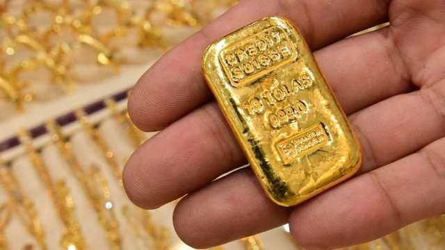 〈貴金屬盤後〉零售銷售潑通膨冷水 黃金連2週上漲 收2月來最高價 (圖片:AFP)
