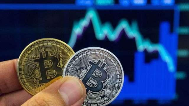 馬斯克震撼彈讓加密貨幣市值蒸發5000億美元 比特幣摔至3個月低點 (圖:AFP)