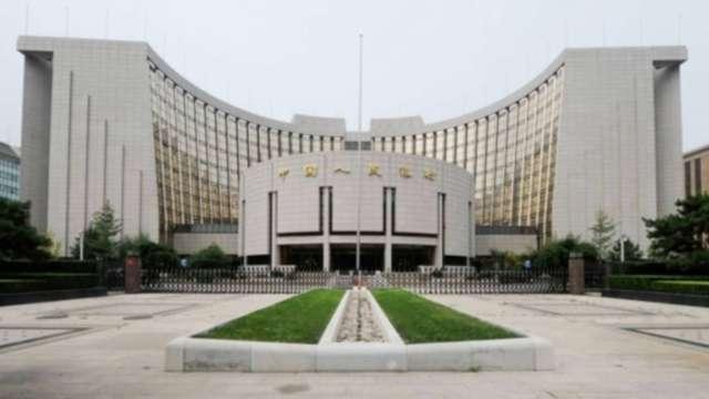 人行官員:為推動人民幣國際化 中國最終必須放棄匯率控制 (圖:AFP)