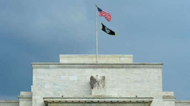 Fed暗示接下來利率會議上開始討論減碼QE。(圖片:AFP)