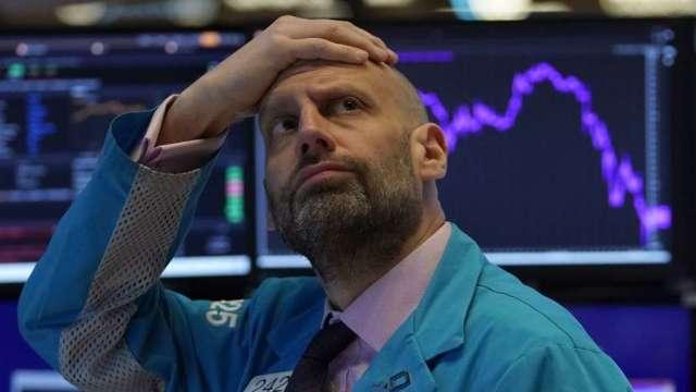 加密貨幣崩潰加速 美股、債券均在下跌 全球市場災情慘重(圖:AFP)