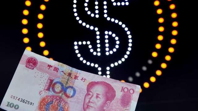 美元表現曇花一現 人民幣中間價升值164基點(圖片:AFP)