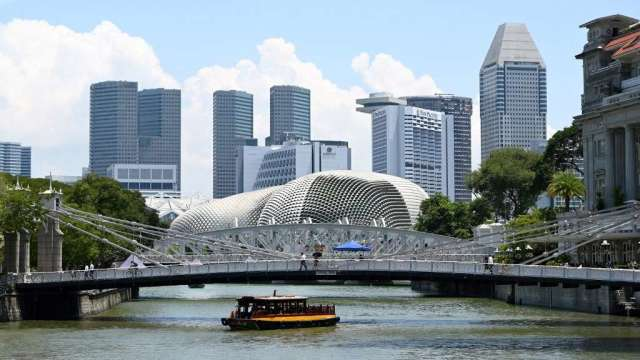 新加坡首季GDP年增1.3% 疫情發展將影響全年表現(圖:AFP)