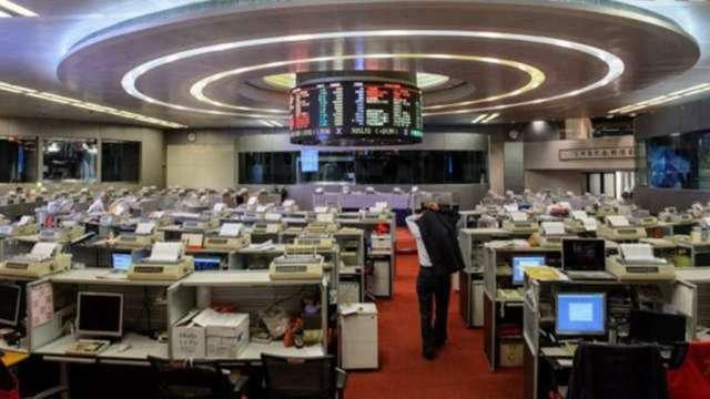 【袁志峰專欄】5月26日 - A股突破,港股升勢可持續 (圖:AFP)
