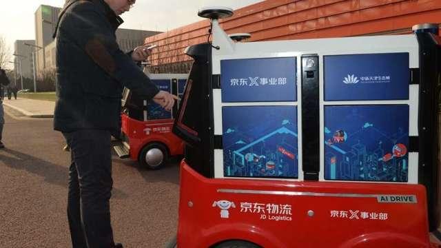 好兆頭 京東物流上市首日開盤飆14% 市值破2800億港元(圖片:AFP)