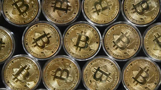 比特幣與黃金此消彼長關係 引華爾街分析師熱議(圖片:AFP)