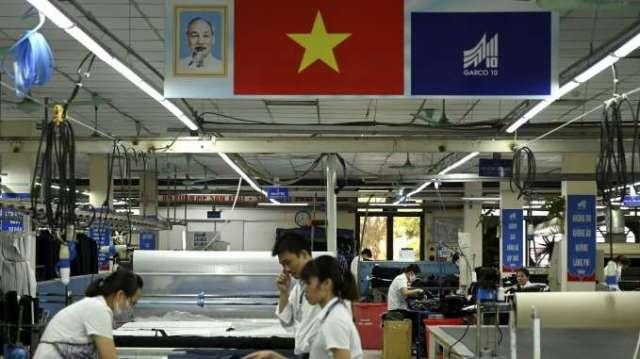 越南疫情快速蔓延 路透:蘋果、三星等科技業供應鏈恐受影響(圖:AFP)