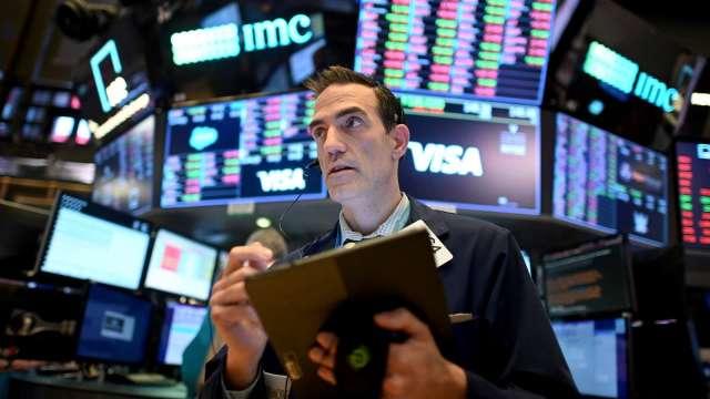 拜登擴大財政預算 全球股市上揚。(圖:AFP)