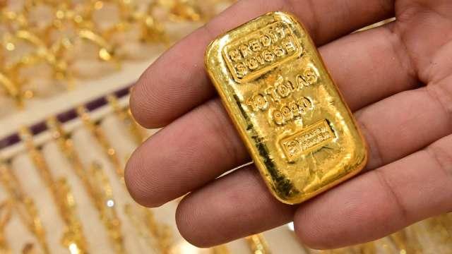 〈貴金屬盤後〉CPI公布在即 黃金叩關失敗 3日來首次收低 未能收復1900美元 (圖片:AFP)