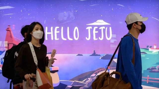 韓國濟州島疫情升溫 觀光客湧入成防疫破口 (圖片:AFP)